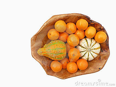 Tangerines and decorative pumpkins
