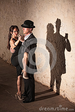 Tango Dancer with Leg On Partner