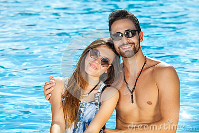 Tanned healthy beautiful young couple.