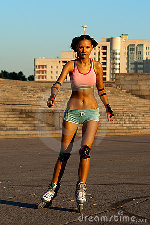 Tanned sexy roller woman