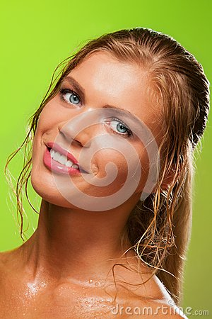 Tanned wet girl smiling