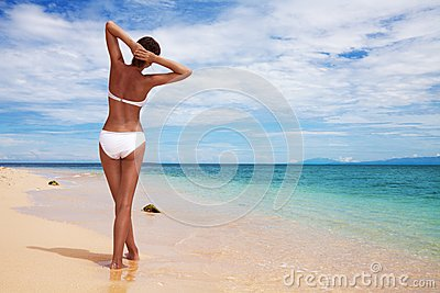 Tanned woman on the beach