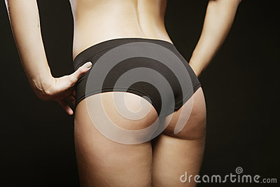 Tanned woman with beautiful sporty buttocks