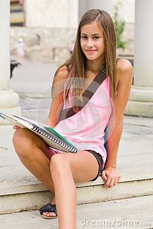 Tanned young student girl.