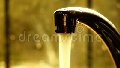 A tap with flowing water. Taken close up stock footage