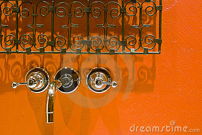 Tap and grates on orange background