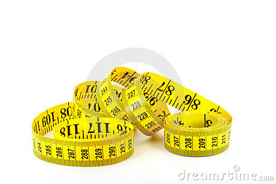 Tape measure coiled on white