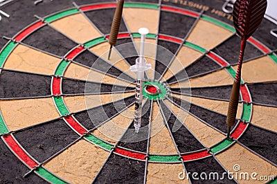 Target darts and syringe