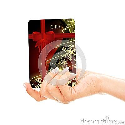 Tarjeta de crédito de la Navidad holded a mano sobre blanco