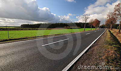 Tarmac road heading to unknown