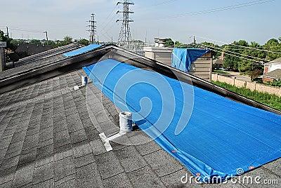Tarpaulins on roofs