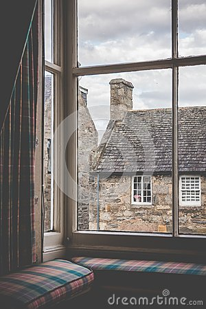 Free Tartan Curtains And Cushions On A Window Seat In An Old Country Stock Image - 103724931