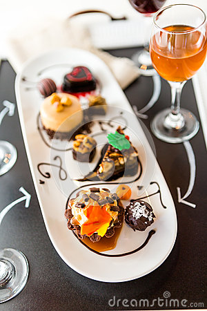 Free Tasting Of Wine And Pattie Chocolate Pastries At The Chocolate. Stock Images - 43846354