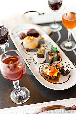 Free Tasting Of Wine And Pattie Chocolate Pastries At The Chocolate. Stock Photo - 43846360