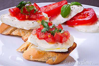Tasty bruschetta on white plate