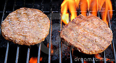 Tasty Burgers On The Barbeque