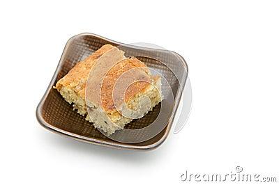 Tasty cake in saucer