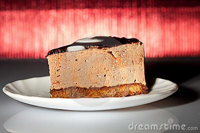 Tasty chocolate cake on redbackground
