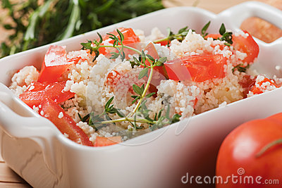 Tasty couscous with herbs ant fresh tomato