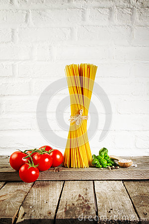 Free Tasty Fresh Colorful Italian Food Raw Spaghetti On Kitchen Table Stock Image - 89584321