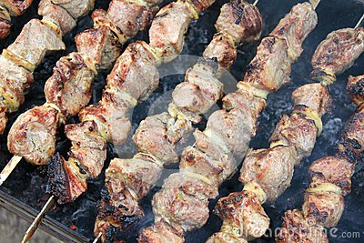 Tasty grilled meat on skewers