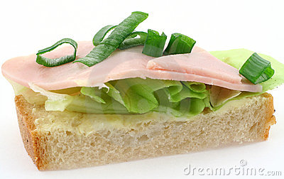Tasty ham sandwich with lettuce and chive on white bread