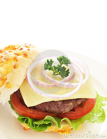 Tasty hamburger with beef patty and tomato