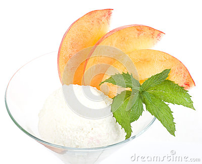 Tasty ice cream dessert with peach
