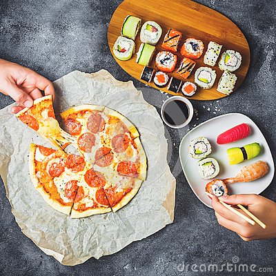 Free Tasty Pizza With Salami, Set Of Sushi Rolls And Hands Take Food. Dark Background. Flat Lay, Top View. Stock Photos - 106228273