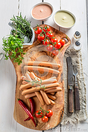 Free Tasty Sausages With Vegetables And Herbs Royalty Free Stock Images - 51951349