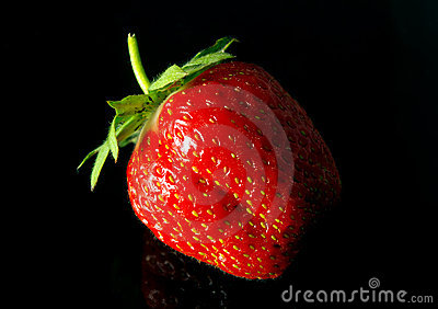 Tasty strawberry on black