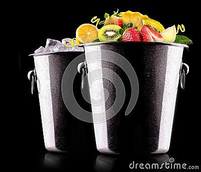 Tasty summer fruits in bucket