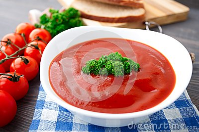 Tasty tomato soup with herbs