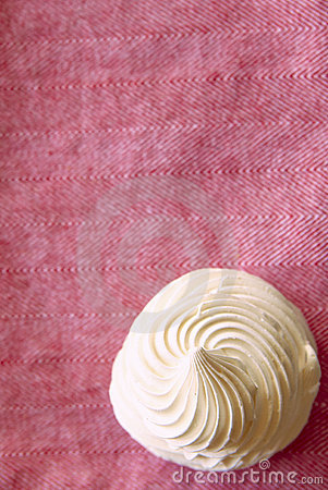Tasty white meringue on a napkin.
