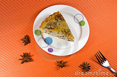 Tasty yellow honey pie with  wallnut decorations.