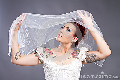 Tattooed Bride with veil