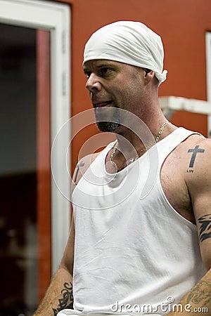 Tattooed man exercising