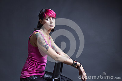 Tattooed woman in pink