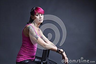 Tattooed woman in pink