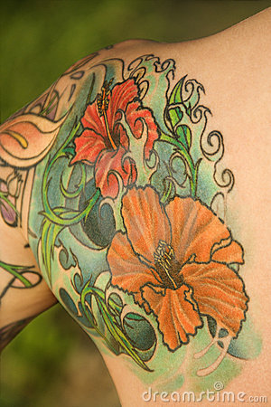 Tattooed woman s shoulder.