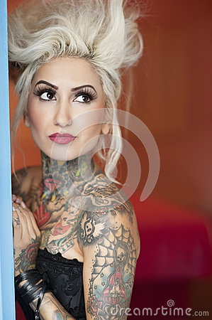 Tattooed young woman looking away