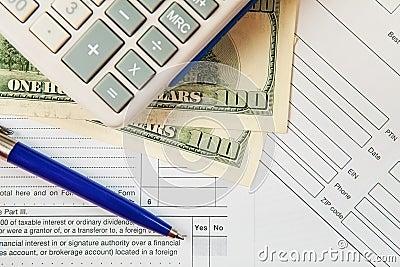 Tax form with hundred dollar bills