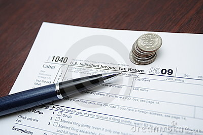 Tax forms, coins and pen Editorial Stock Photo