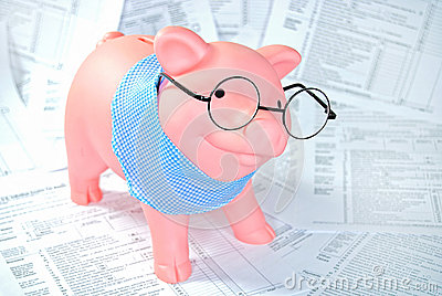 Tax forms with piggy bank