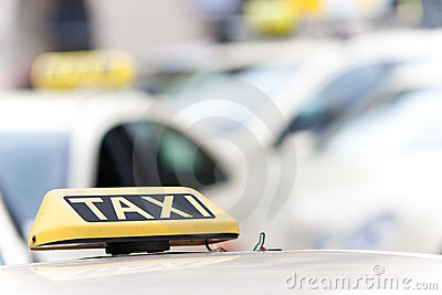 Taxi cab signs on vehicles
