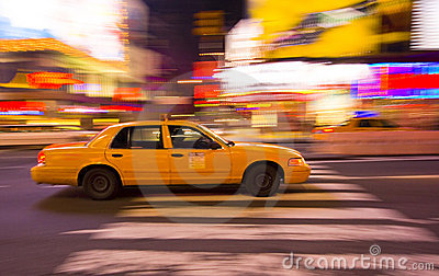 Taxi cab speeding through city