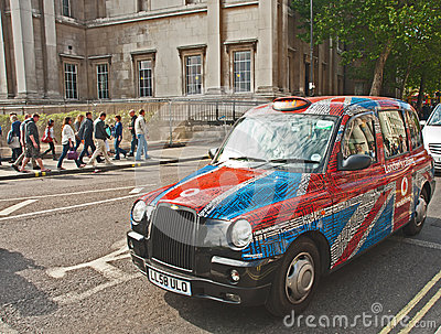 Taxi covered by Union Jack Flag Editorial Image