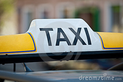 Taxi sign on a car roof