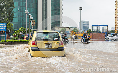 Taxi Struggling Through Flood Editorial Stock Photo