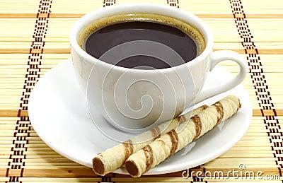 Taza de café con las galletas